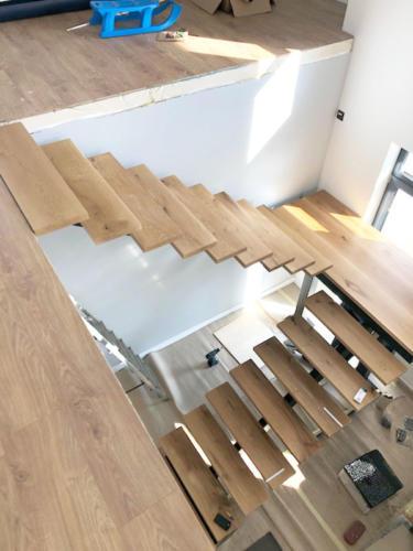 Designerskie schody wewnętrzne metalowo-drewniane - KIM Ogrodzenia Budzyń